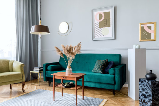 Minimalist interior design with sofa, coffee table and framed posters