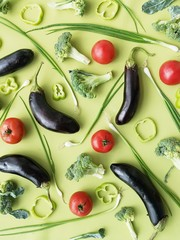 Fototapete - creative flat layout of vegetables top view, eggplant and broccoli on a green background