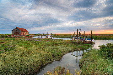 Wall Mural - Moody sunrise at the old harbour at Thornham