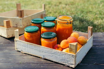 apricot jam in jars on wooden board outdoor