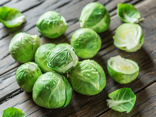 Brussel sprouts on the old wooden table.