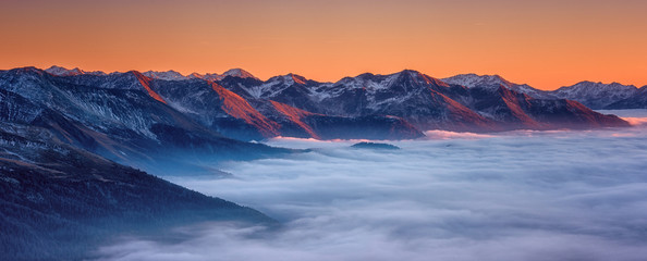 Amazing nature landscape, scenic panoramic top view of the Alps mountain range with clouds at sunset, outdoor travel background, Hohe Tauern national park, Carinthia, Austria Wall mural