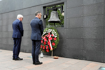 German Foreign Minister Heiko Maas and his Polish counterpart Jacek Czaputowicz pay respect at the Wall of Rememberence as they commemorate the 75th anniversary of Warsaw Uprising at Warsaw Rising Museum in Warsaw