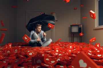 Mann schützt sich vor herabfallenden Likes
