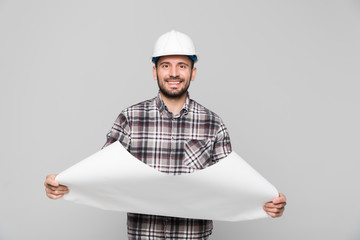 Young construction worker excited to start work on a new project isolated on white