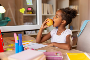 Schoolgirl eating an apple