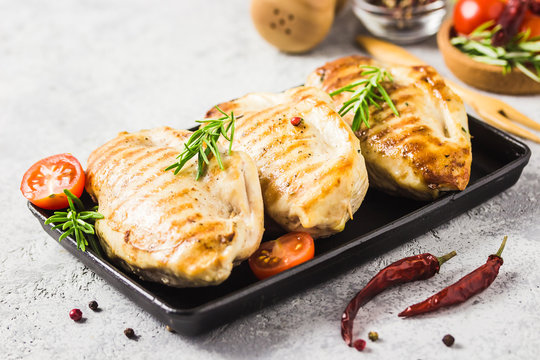 Stuffed grilled chicken breasts in cast iron skillet. Selective focus, copy space.