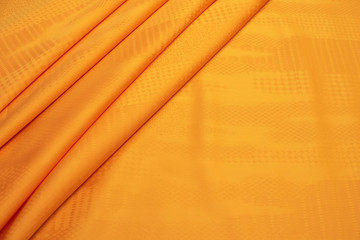 The texture of the cotton fabric is orange. Background, pattern. Fototapete