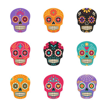 Dia de los muertos. Vector collection of Mexican traditional sugar skulls in various colors. Isolated on white.