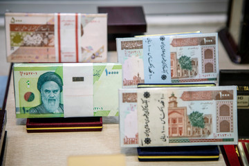 Iranian currency is displayed at an exchange shop in Tehran