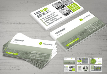 Business Card Layout with Light Gray and Pale Green Elements