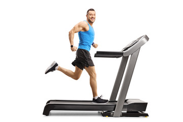 Male athlete running fast on a treadmill