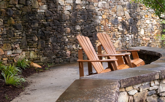 Two chairs on a stone ledge 2