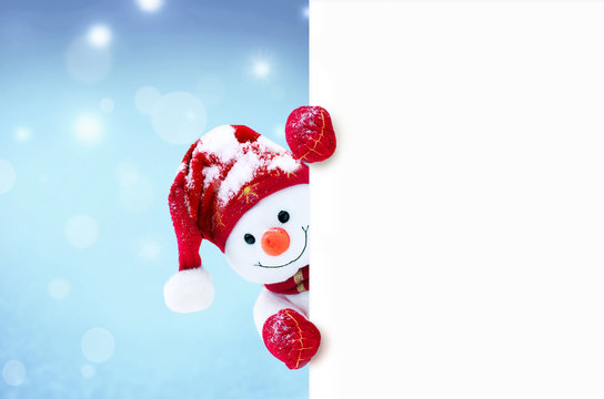Little snowman in caps and scarfs on snow in the winter. Background with a funny snowman. Christmas card.