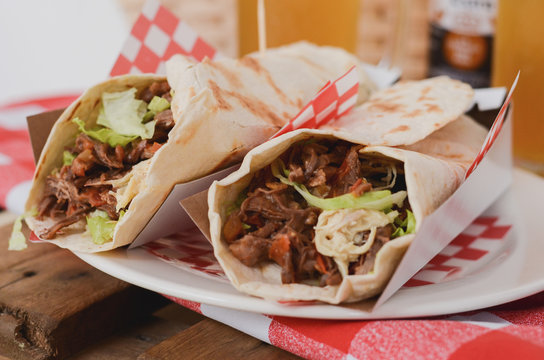 Burritos stuffed with meat and vegetables. Mexican food.