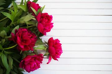 a bouquet of beautiful peonies lies
