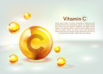 Fototapeta Vitamin C gold shining icon. Ascorbic acid. Shining golden substance drop. Nutrition skin care. Vector. obraz
