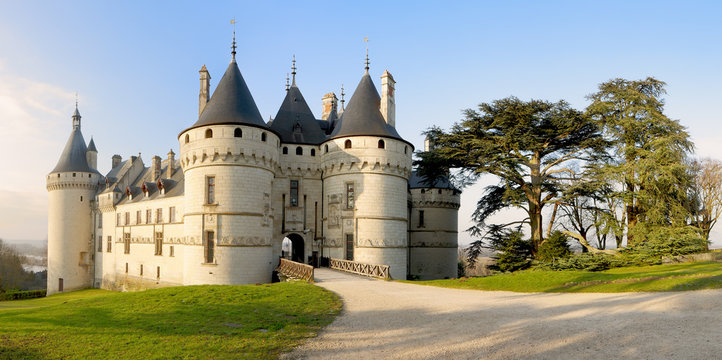 Chaumont Castle france - Panoramic wide view to the entrance and the garden with trees and grass at sunrise