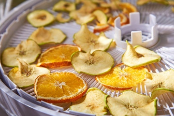 Apple and orange chips cooked in a dehydrator, the theme of healthy eating