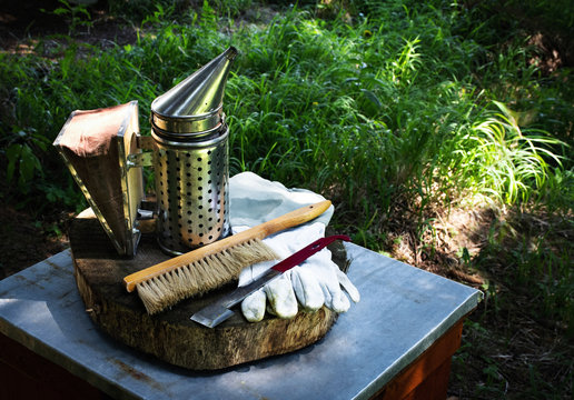 beekeeping background smoker and gloves