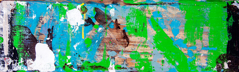Abstract art with splashes of multicolor paint, as a fun, creative & inspirational background texture - in long panorama / banner.