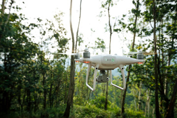 White drone flying in the tropical forest Wall mural