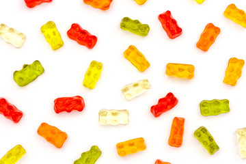 Pattern of colorful fruit gummy bears isolated on white background
