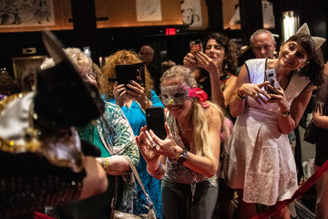 Participants take a picture of Meril during the Algonquin Hotel's Annual Cat Fashion Show in the Manhattan borough of New York City