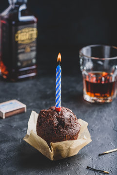 Chocolate muffin with birthday candle
