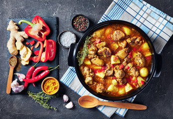 chicken curry in a black pan, top view