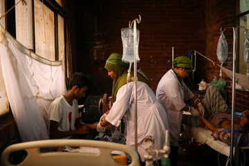 Nurses treat patients infected with dengue at the Shaheed Suhrawardy Medical College and Hospital in Dhaka