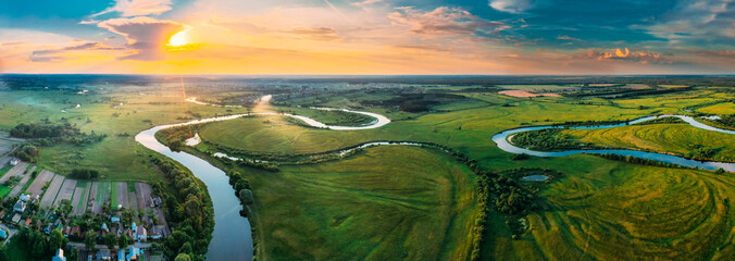 Aerial View Green Forest Woods Meadow And River Landscape In Sunny Spring Evening. Top View Of Beautiful European Nature From High Attitude In Summer Sunset Sunrise. Panorama, Bird's Eye View. Belarus
