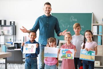 Cute children with teacher in classroom