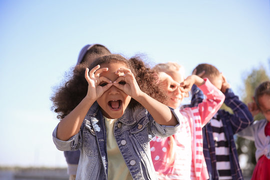 Group of happy children having fun outdoors