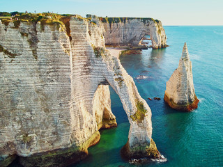 Picturesque landscape of white chalk cliffs and natural arches of Etretat, France Wall mural