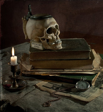 Still life Veritas with skull, candle, old books and pocket watch