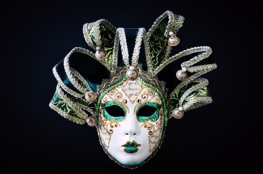 Venetian carnival mask isolated on black background. Traditional carnival in Venice. Green and white mask with glitters. Masquerade party. Mardi Gras, costumes. Concept, abstract
