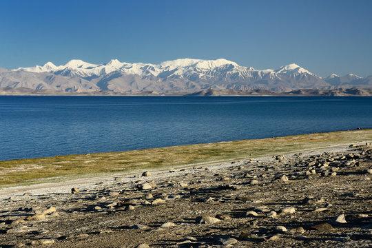 The beautiful Karakul lake by the Pamir highway. View on the lake and Peak Lenin near Karakul village in the Pamirs, Tajikistan, Central Asia