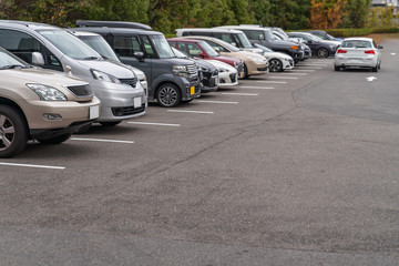 row of cars parked in outdoor parking