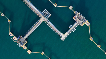 Aerial view crude oil and gas terminal, Loading arm oil and gas refinery at commercial port. - fototapety na wymiar
