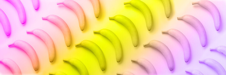 Geometric colorful fruit pattern. Bananas over rainbow gradient background. Banner. Top view. Pop...