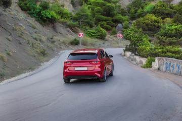 Car move along a winding mountain road