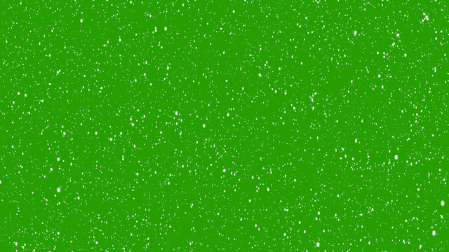 Realistic snow falling on green background. Isolated Flakes to down, Christmas animation with alpha channel.