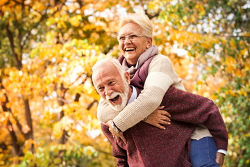The older couple having fun entertained after all these years as much as the first meeting Wall mural