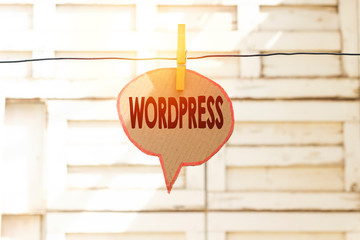 Wordpress speech bubble on hanging line,  Conceptual Photo Free Source Publishing Software That Can Installed Web