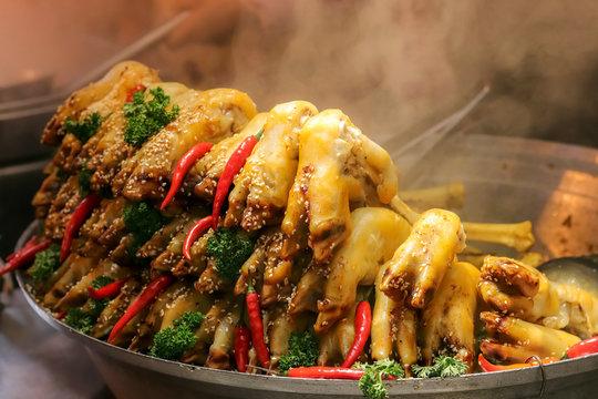 """yang ti zi"" sheep hooves street food in Xi'an Muslim Quarter, China"