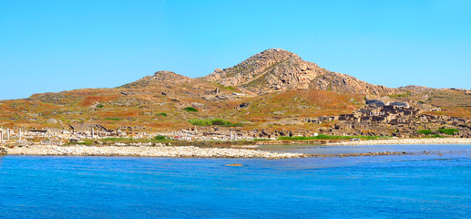 panoramic view from the sea of Delos, Cyclades island in the heart of the Aegean Sea