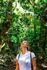 Woman exploring in tropical rainforest on Queensland's Gold Coast Hinterland