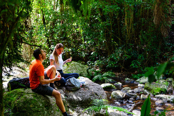 Couple enjoying lunch in lush Australian rainforest