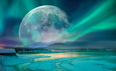Northern lights (Aurora borealis) in the sky with super full moon - Tromso, Norway